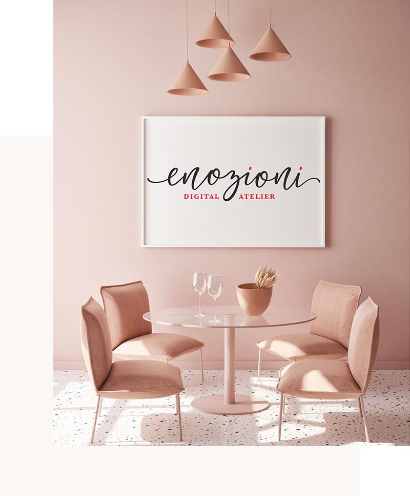 sedie e tavolo e quadro con scritta Enozioni
